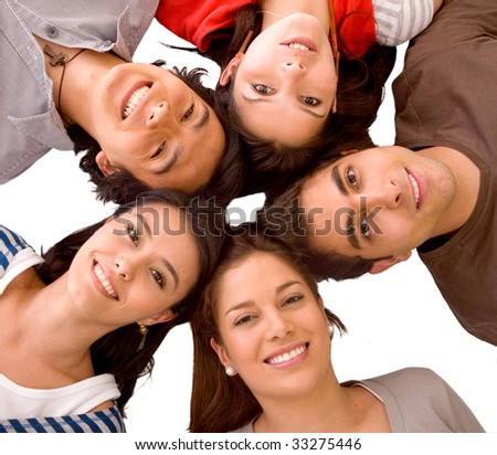 happy group of friends with their heads together on the floor isolated - stock photo