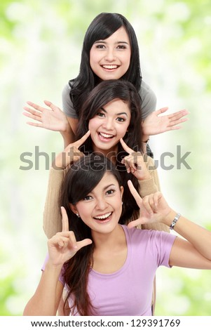 Happy group of girls in good pose smiling isolated on white background