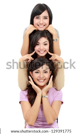 Happy group of girls in good pose smiling isolated on white background - stock photo