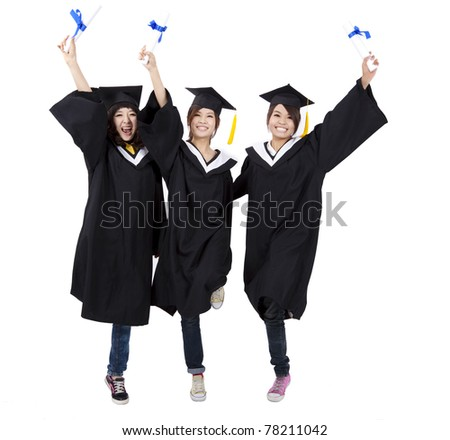 happy group of  graduation girls holding their diploma - stock photo