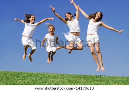 happy group of kids jumping - stock photo