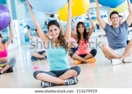 Happy group of people at the gym doing Pilates  - stock photo