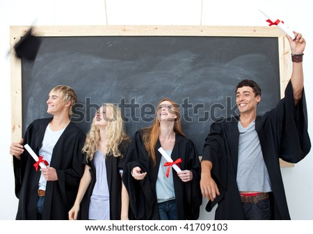Happy group of people celebrating after Graduation - stock photo