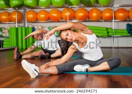 Happy group of people exercising at the gym - stock photo