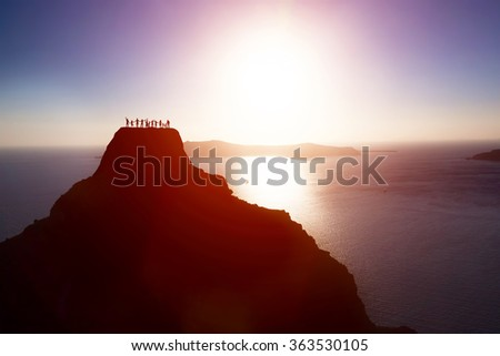 Happy group of people, friends, family on the top of the mountain over ocean celebrating life, success. Children, parents, seniors. Conceptual - stock photo