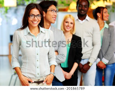 Happy group of people standing together - stock photo