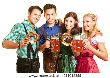 Happy group of people with beer and pretzel having fun at Oktoberfest - stock photo