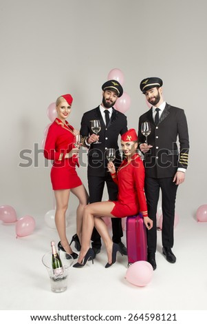 Happy group of pilots and stewardesses  - stock photo