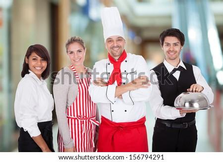 Happy Group Of Restaurant Staff Smiling Indoor - stock photo