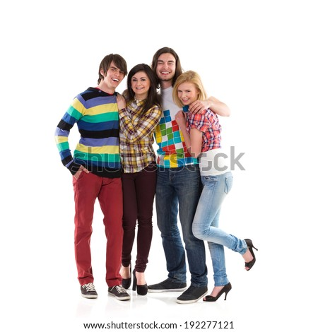 Happy group of students. Four smiling young students standing together. Full length studio shot isolated on white. - stock photo