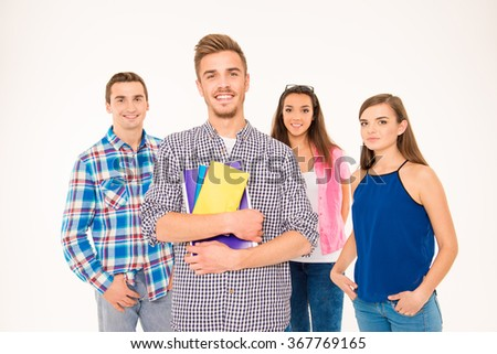 Happy group of students holding books