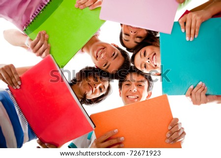 Happy group of students holding notebooks - isolated over white - stock photo