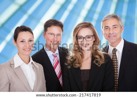 Happy Group Of Successful Businesspeople Smiling Over Blue Background - stock photo