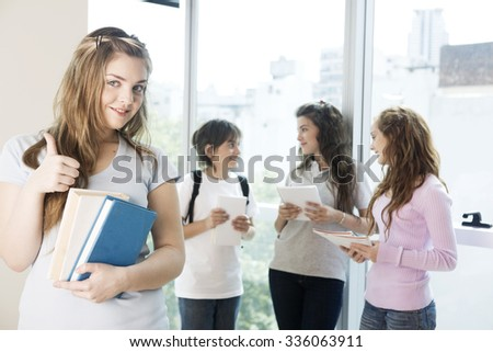 Happy group of teen students with books