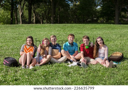 Happy group of teens students with backpacks - stock photo