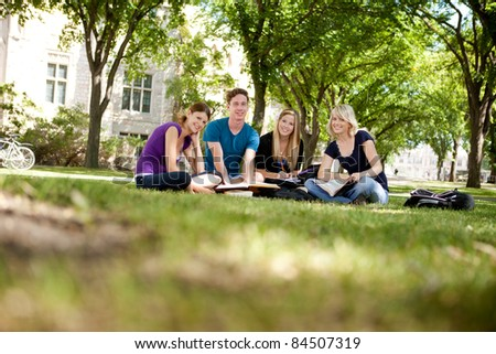 Happy group of university students looking at the camera - stock photo