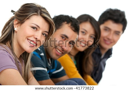 Happy group of young adults isolated over a white background - stock photo