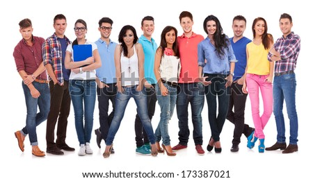 happy group of young casual people standing together on white background