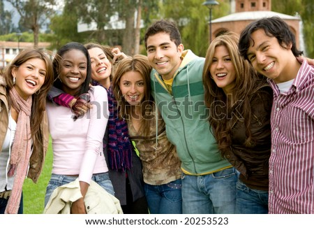 happy group of young people at a university college - stock photo