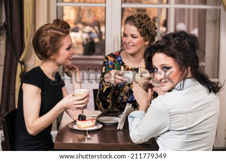 Happy group people drinking coffee at cafeteria - stock photo