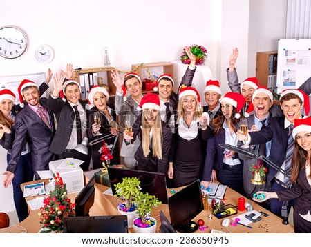 Happy group people in santa hat at Xmas business  party. - stock photo