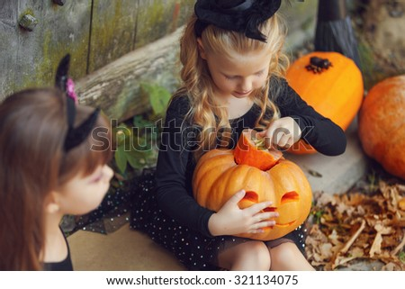 Happy group witch children during Halloween party