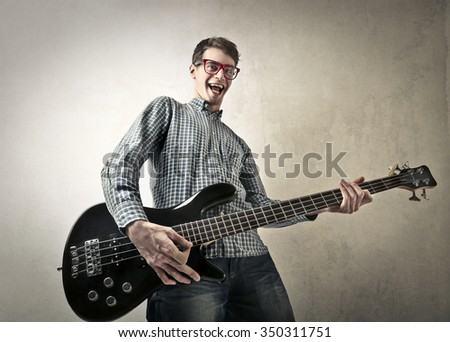 Happy guitarist - stock photo
