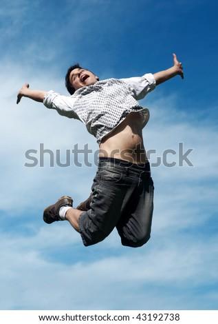 happy guy jumping - stock photo