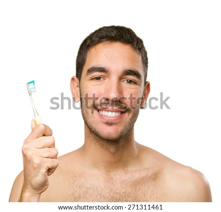 Happy guy with a toothbrush - stock photo