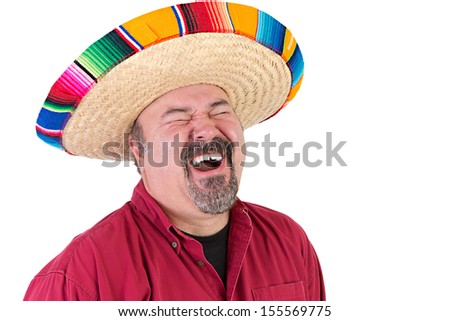 Happy guy with sombrero hat laughing out loud with his eyes closed - stock photo