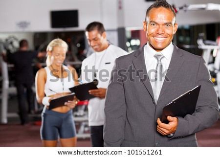 happy gym manager and trainers - stock photo