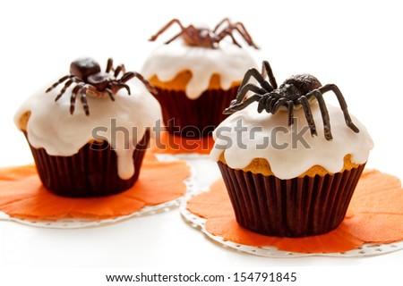 Happy Halloween cupcakes decorated white cream and black chocolate  - stock photo