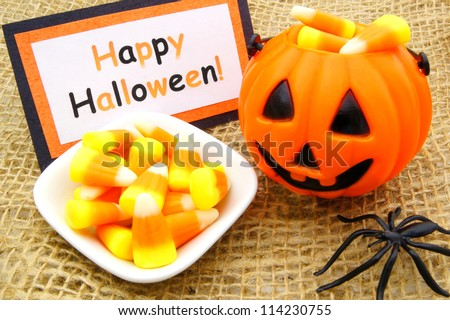 Happy Halloween tag with candy corn and jack o lantern on burlap - stock photo