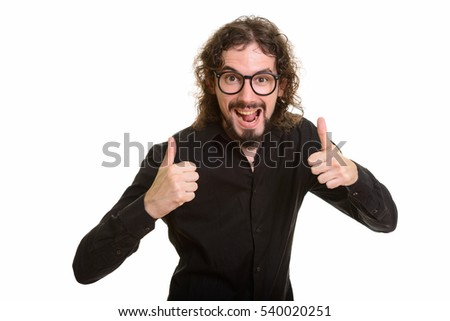 Happy handsome Caucasian man giving thumbs up