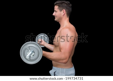 Happy handsome crossfitter lifting up barbell on black background