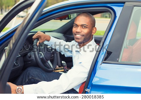 Happy handsome man in his new blue car - stock photo