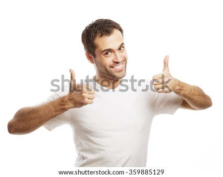 Happy handsome man showing thumbs up  - stock photo