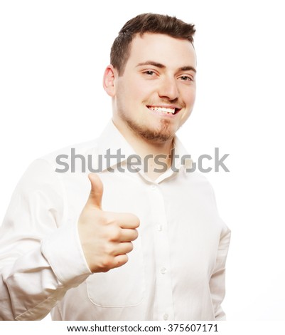 Happy handsome man showing thumbs up