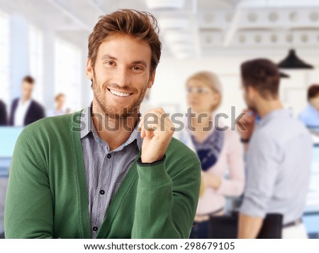 Happy handsome man smiling, looking at camera. - stock photo