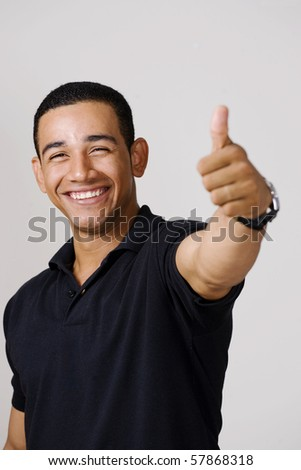 Happy handsome man with thumbs up - stock photo