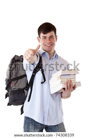 Happy handsome student with books shows thumb up. Isolated on white background.