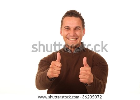 Happy handsome young man showing thumbs up sign