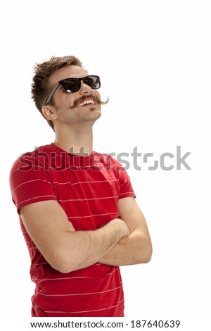 Happy, handsome young man with hipster sunglasses, crosses his arms, looks up and smiles, isolated on white background