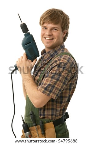 Happy handyman posing with power drill, smiling. Isolated on white. - stock photo
