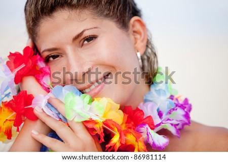 Happy Hawaiian woman enjoying her holidays at the beach - stock photo
