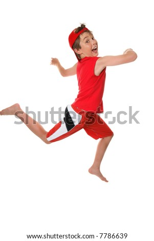 Happy healthy boy leaping or running and having fun - stock photo