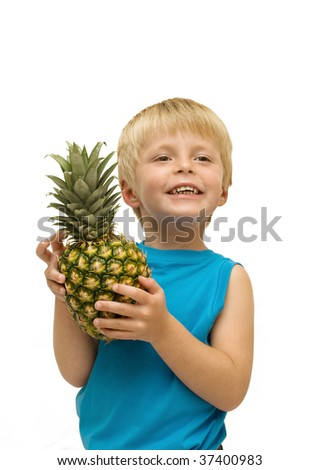 Happy healthy child holds a pineapple. - stock photo