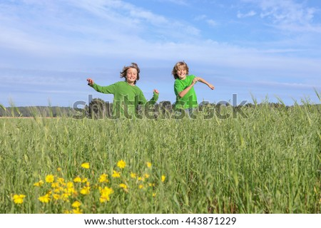 happy healthy kids running, playing, outdoors in summer