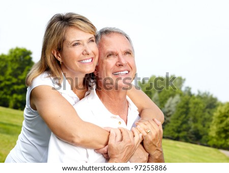 Happy healthy senior couple having fun in the park. - stock photo