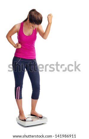 happy healthy woman celebrates her weightloss on scale diet concept - stock photo
